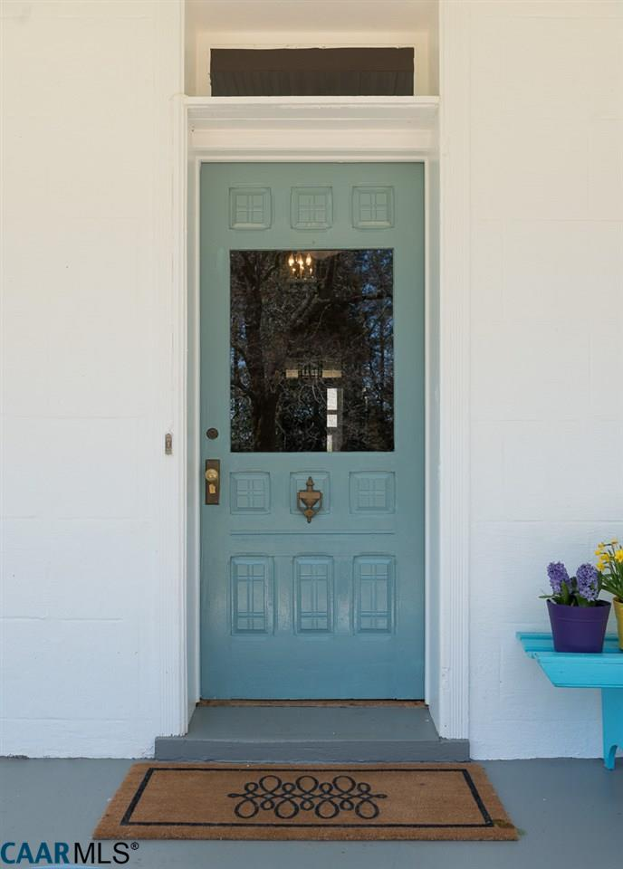 Closeup of aqua blue front door on farmhouse