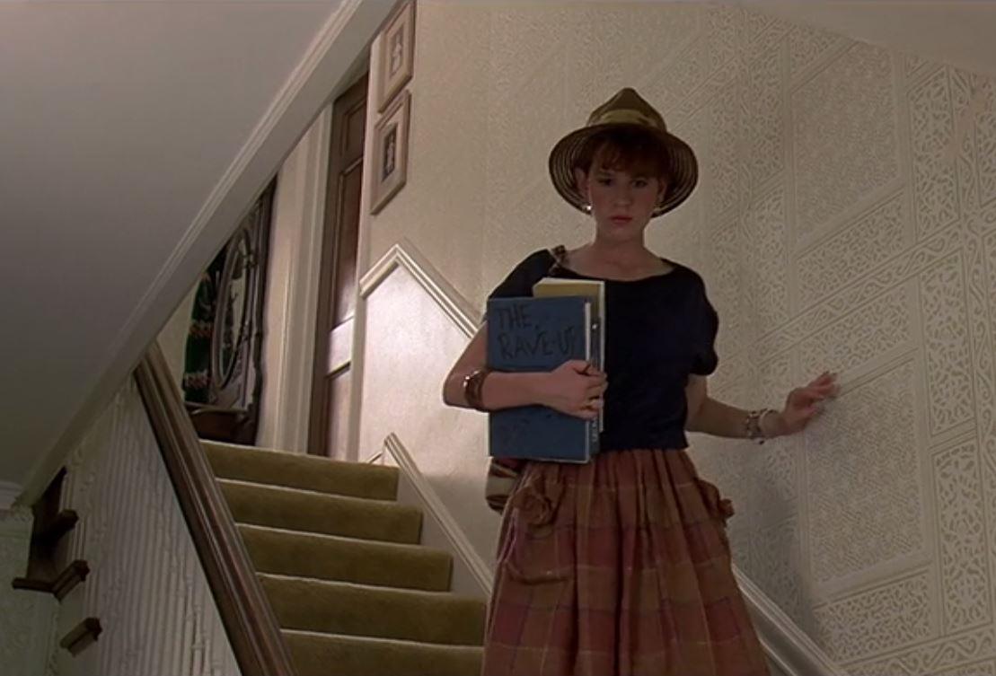 Molly Ringwald walking downstairs