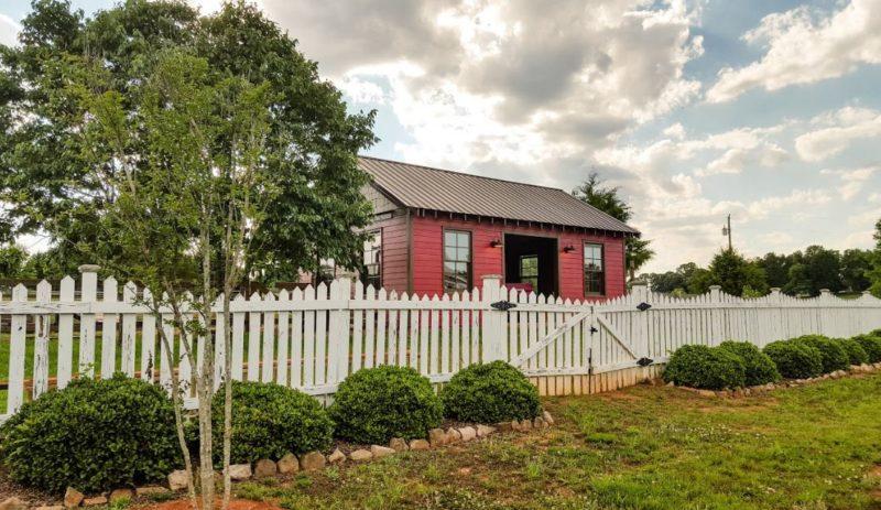 Red barn behind farmhouse