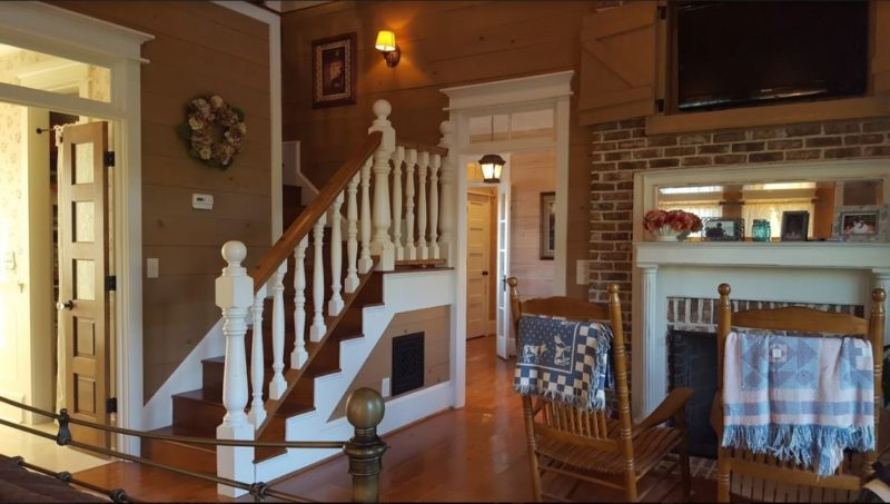 Staircase leading upstairs from main bedroom
