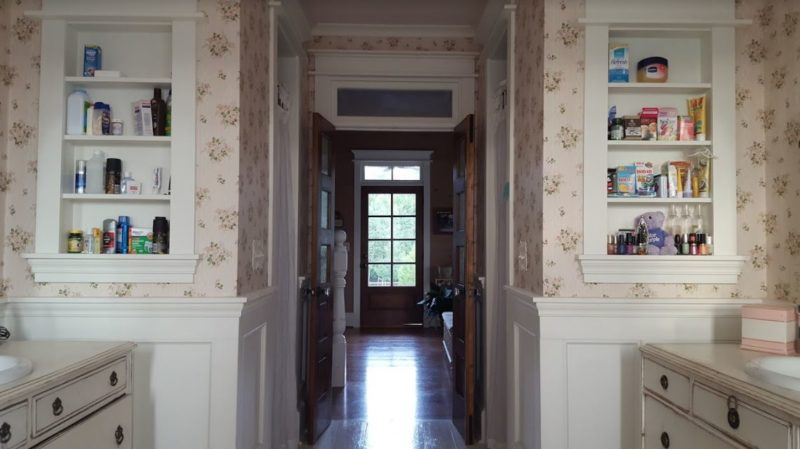 Looking down the hall to the door from the bathroom