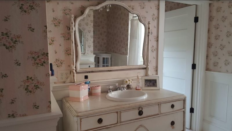 Bathroom with antique dresser and mirror for sink vanity