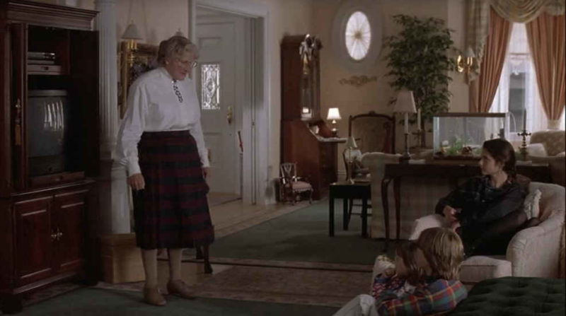 Mrs. Doubtfire standing in the living room