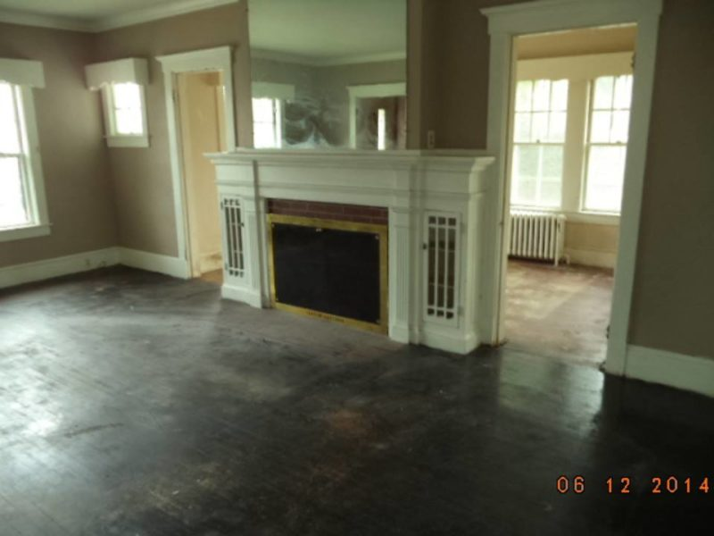 Living room fireplace with mirror before remodel