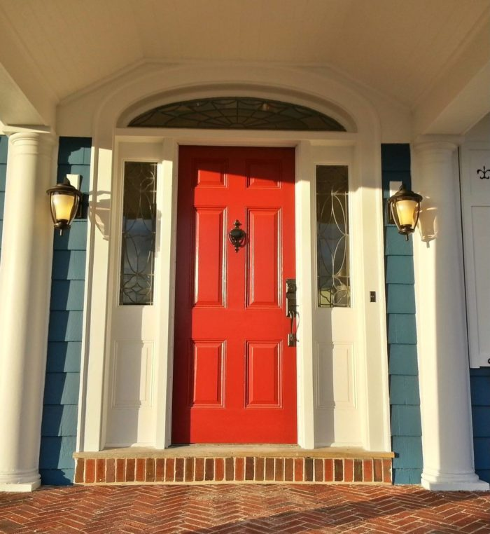 Closeup of red door with sidelights after remodel