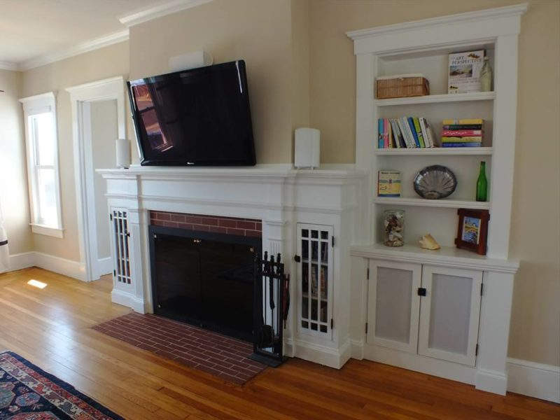 Living room fireplace with bookshelves after remodel