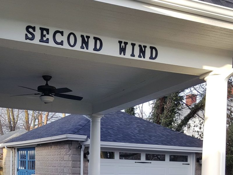 New sign with house name Second Wind on exterior overhang