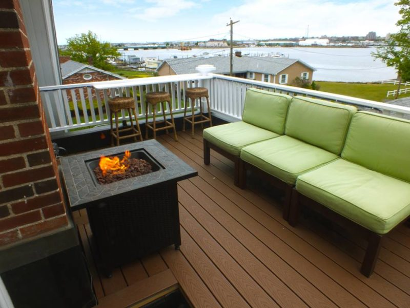 Balcony with fire pit and outdoor furniture