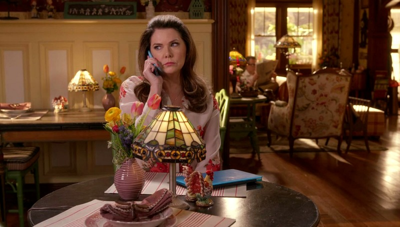 Lauren Graham sitting at a dining table at the Dragonfly Inn