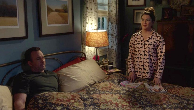 Lorelai standing next to her bed