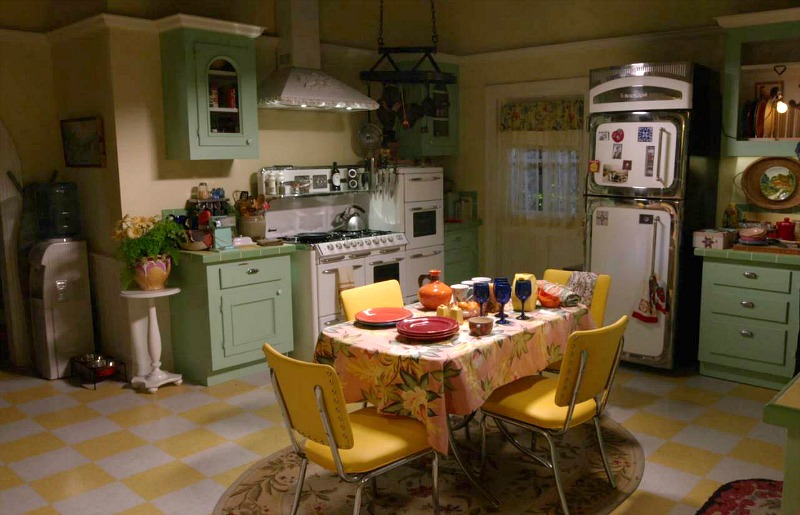 Lorelai\'s kitchen with green cabinets and yellow-checked floor