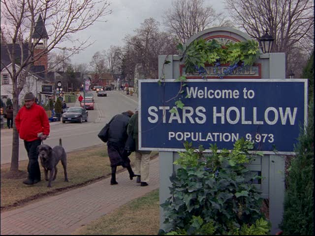 Sign saying Welcome to Stars Hollow Population 9,973