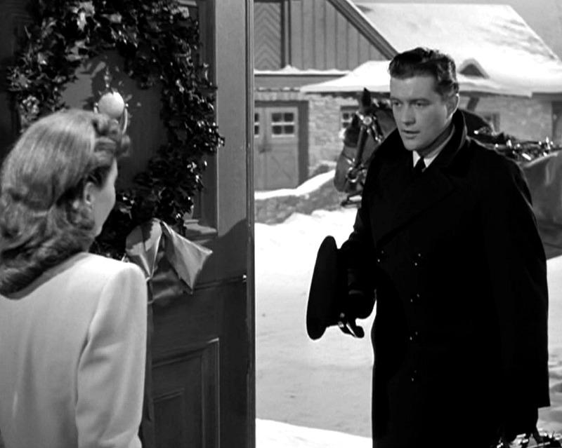 Dennis Morgan enters the front door of the farmhouse