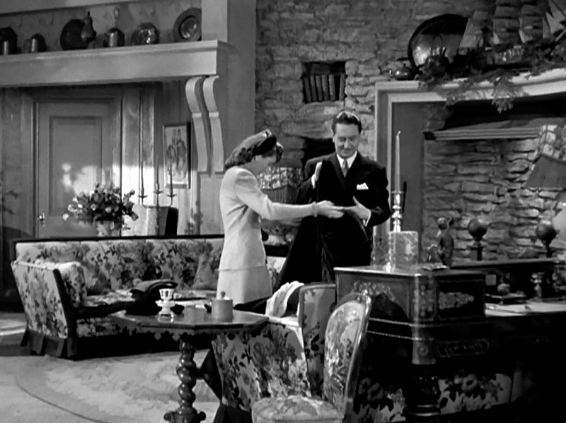 Elizabeth and John in the farmhouse living room