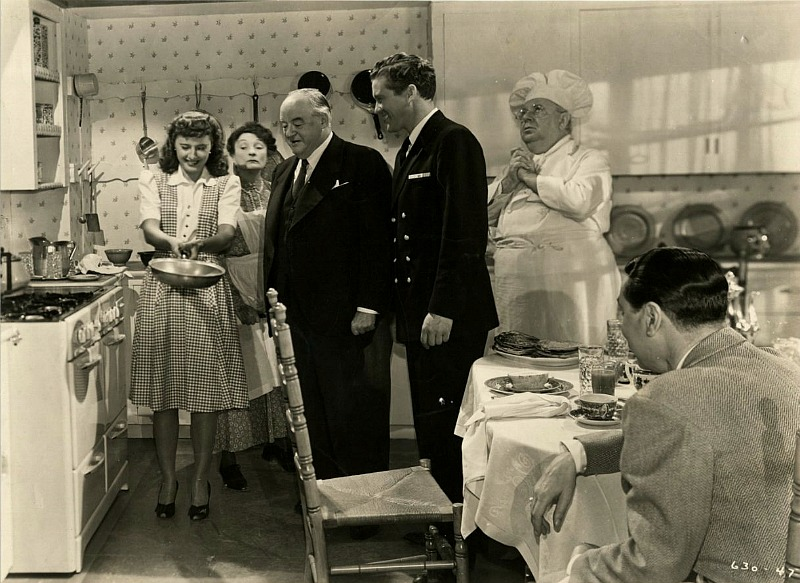 Elizabeth Lane flipping pancakes in promotional still for Christmas in Connecticut