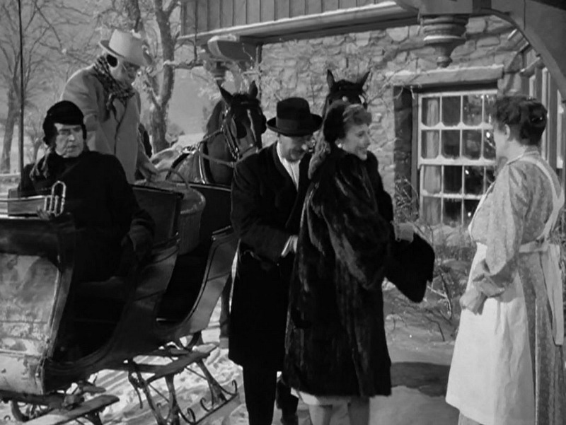 Elizabeth Lane and friends arrive at the farmhouse by horse and sleigh