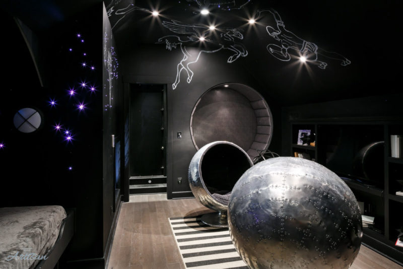 Black-painted playroom with stars on ceiling