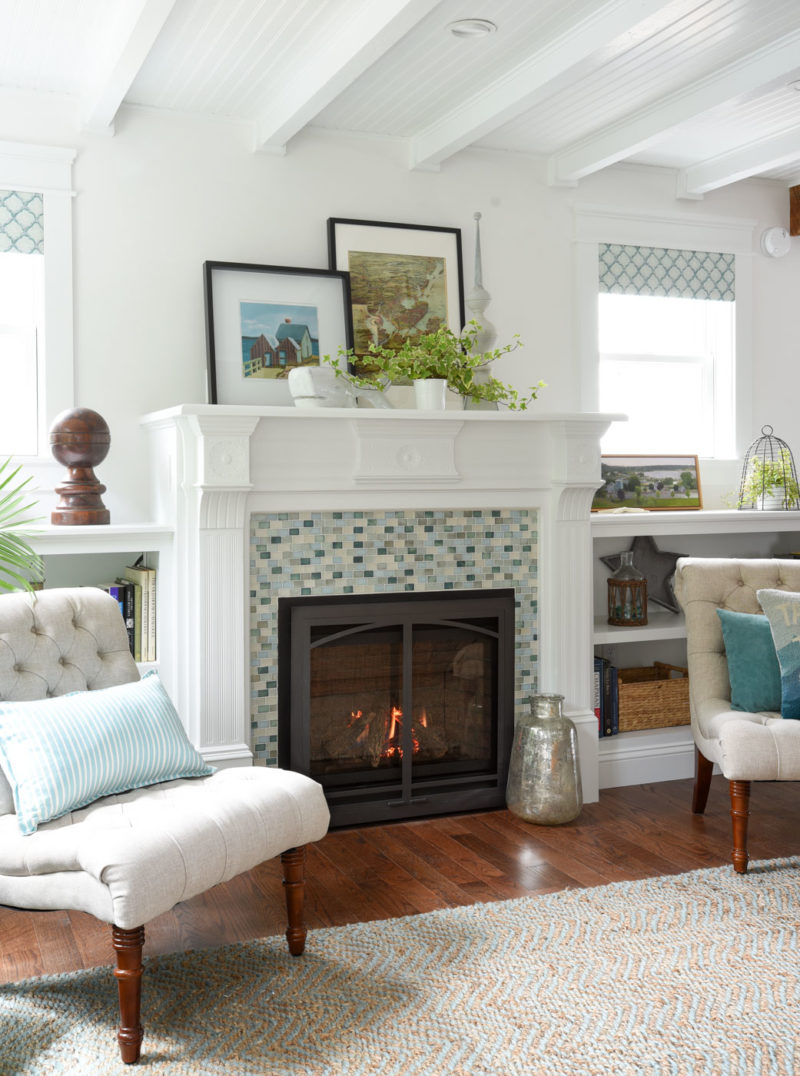 A living room fireplace with blue and green tiles