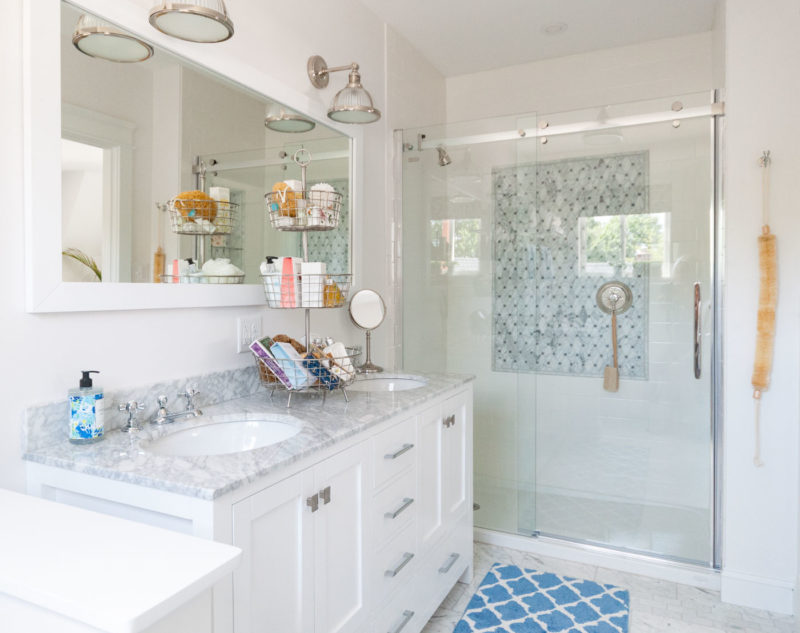 Bathroom with dual sinks and shower