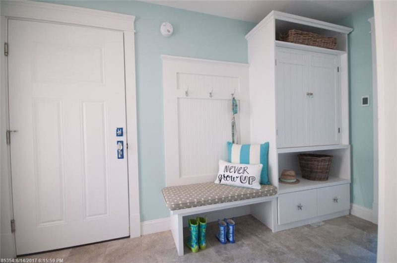 Mudroom with beadboard on wall and built-in bench