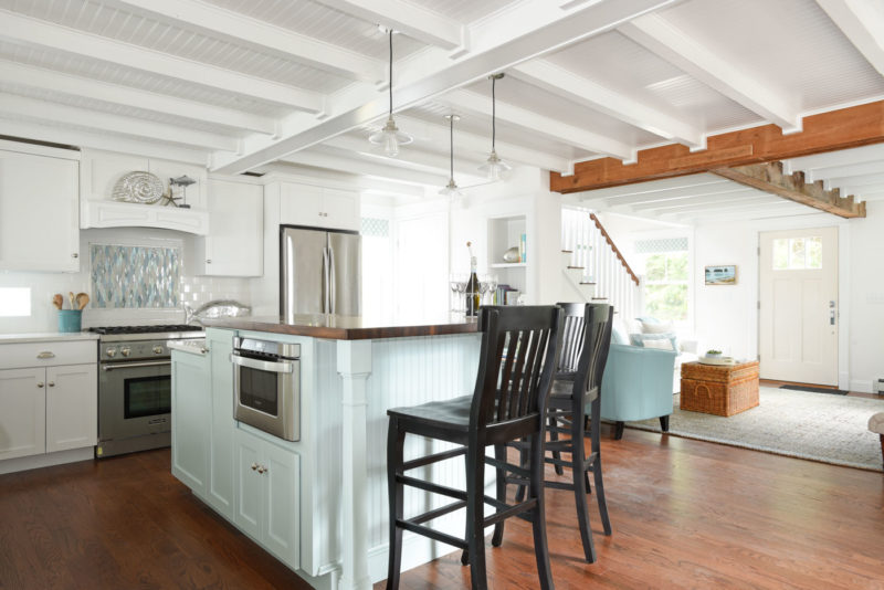 Kitchen island with black bar stools