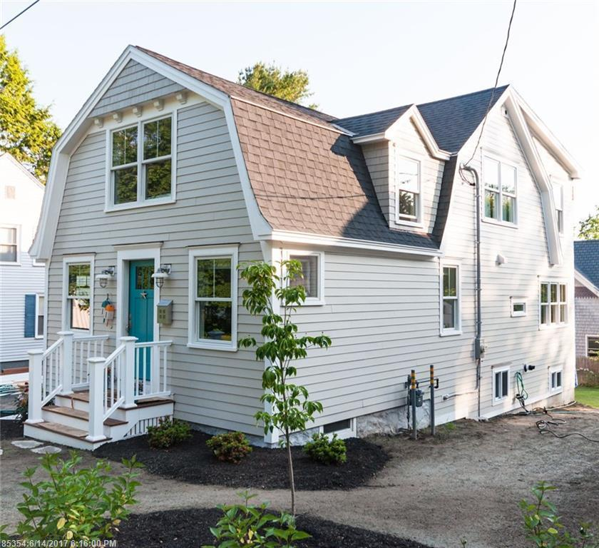 Front exterior of house with teal blue door