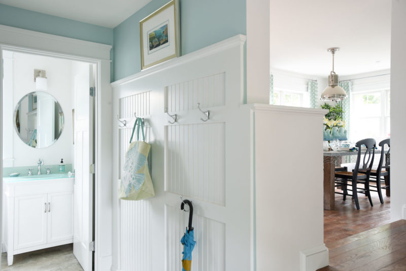 Beadboard in mudroom with hooks for coats