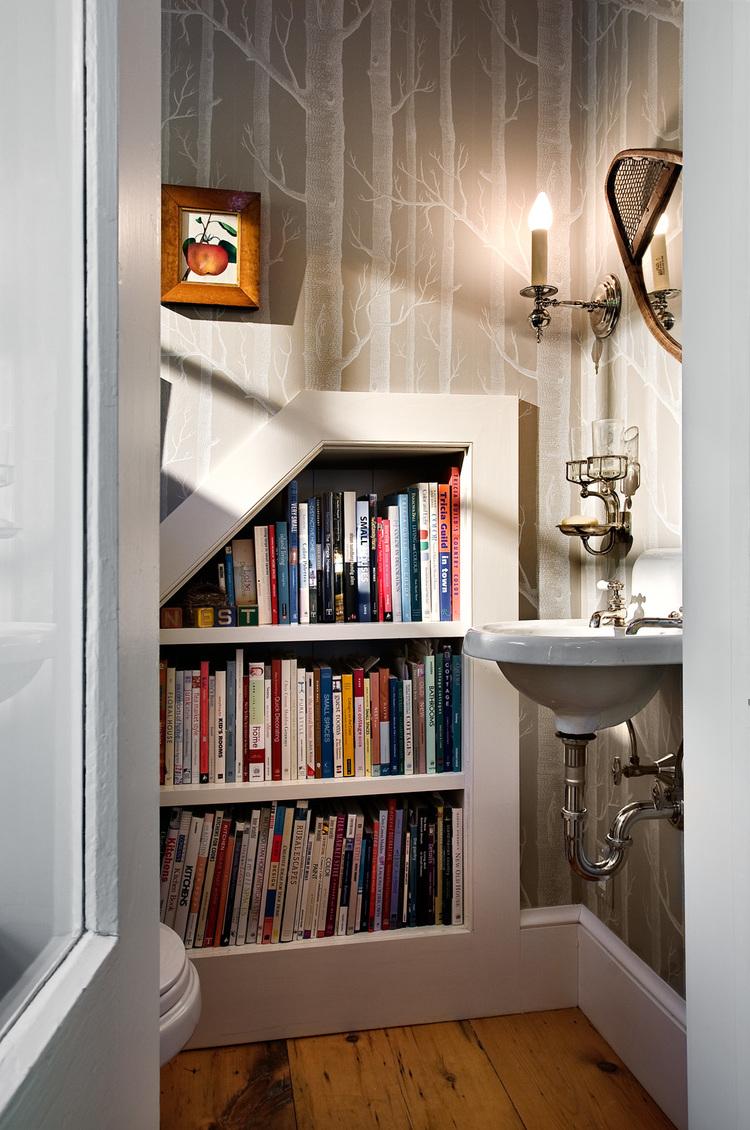 Powder room with built-in bookshelves