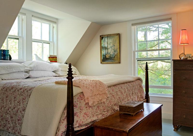 Upstairs bedroom with bed in dormer window