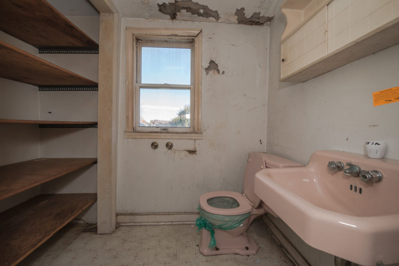 Bathroom with pink fixtures before remodel
