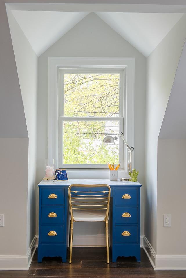 Blue desk in dormer window