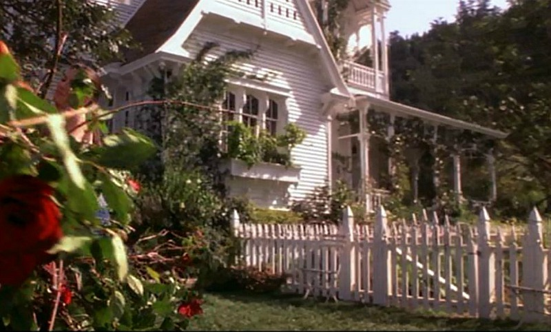 white picket fence side of house