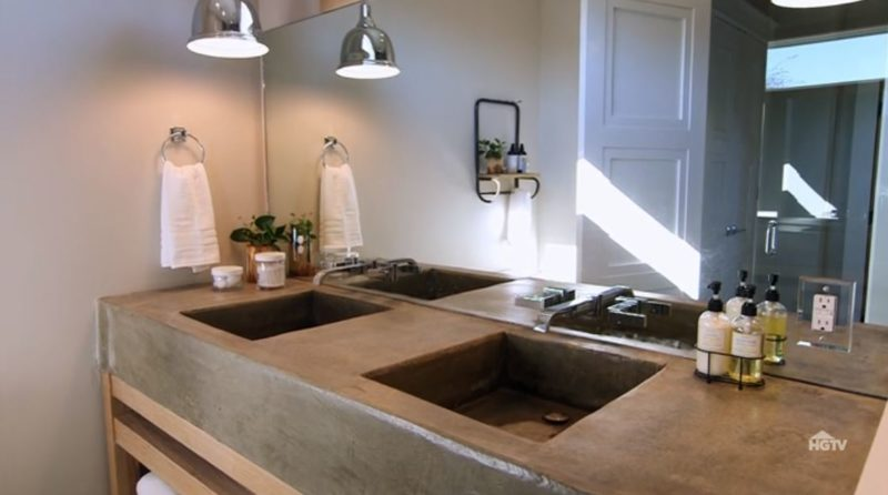 bathroom with concrete countertops