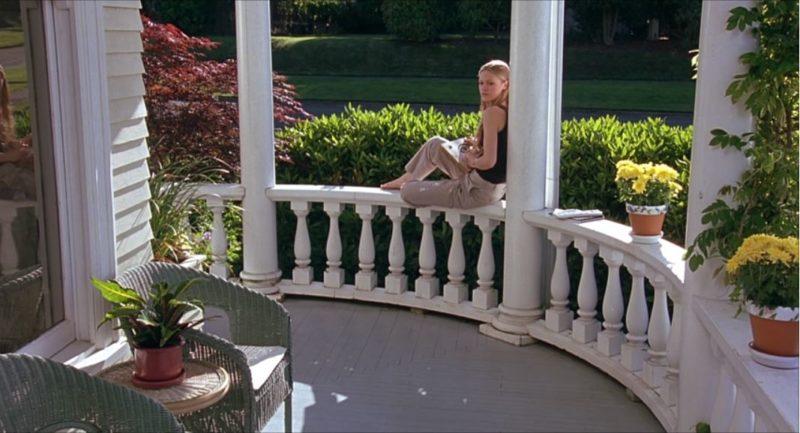 Julia Stiles on front porch