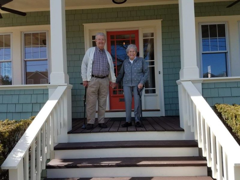 Original owners of bungalow on the front porch