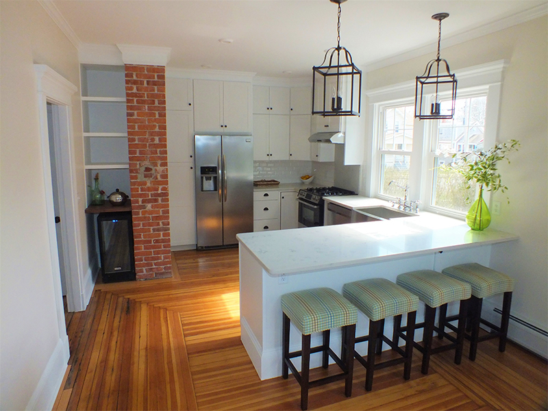 Newly remodeled kitchen with brick pillar