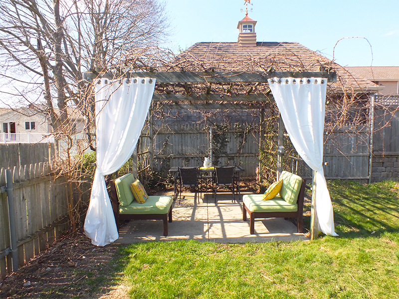 Backyard patio with pergola and outdoor seating
