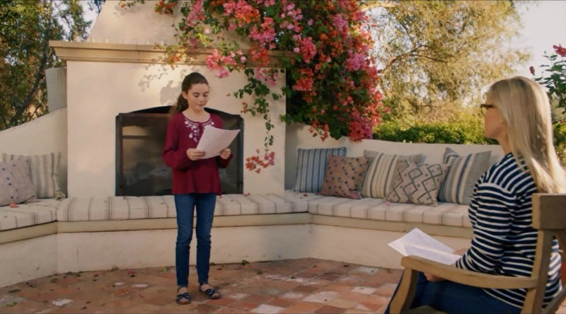 Home Again movie house patio with fireplace