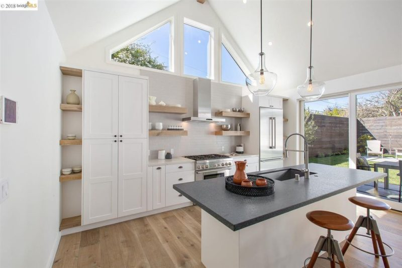 A kitchen with island and vaulted ceiling