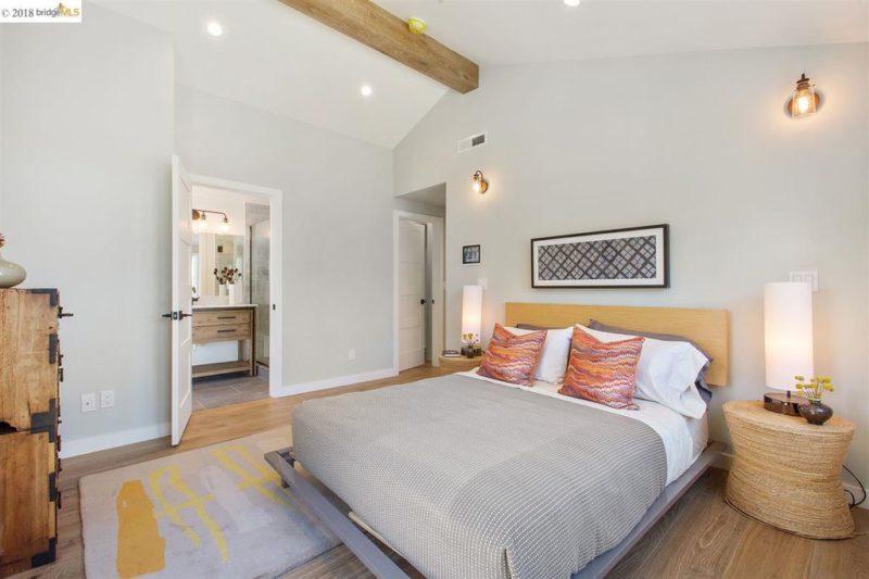 Owner\'s suite with bed and door open to bathroom