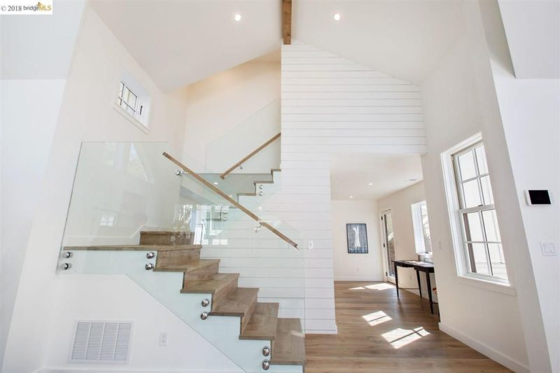 Staircase with plexiglass railing