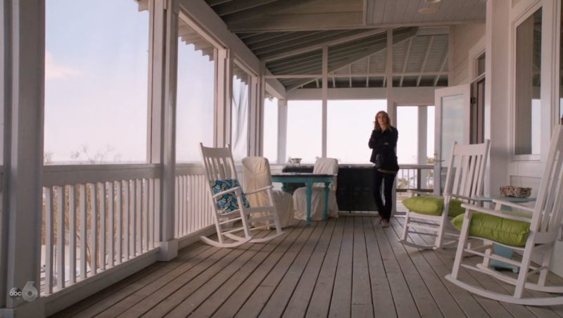 Emily on screened porch of beach house