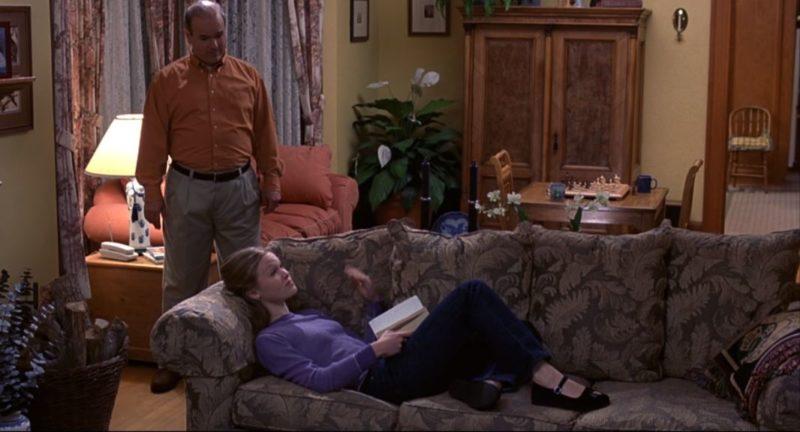 Julia Stiles on living room sofa