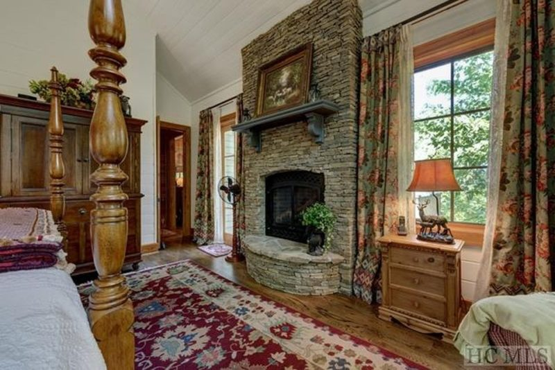 Stone fireplace in bedroom