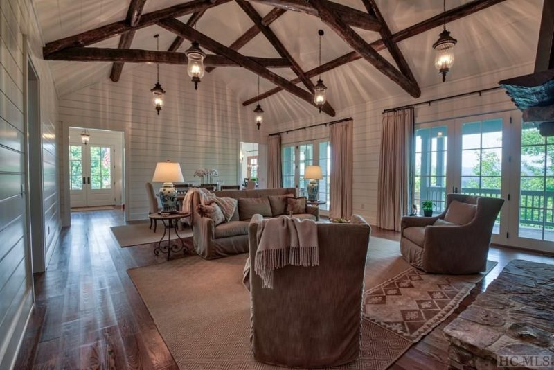 A living room with vaulted beamed ceiling