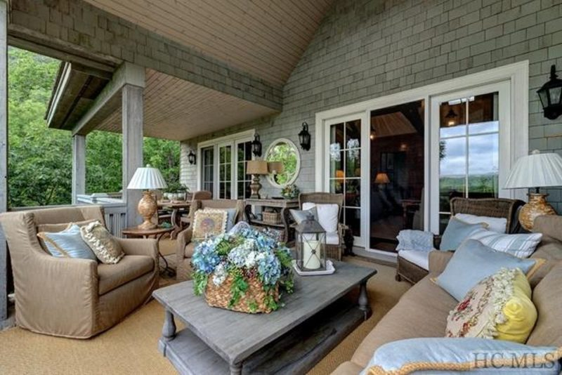 Back porch with sofa and coffee table