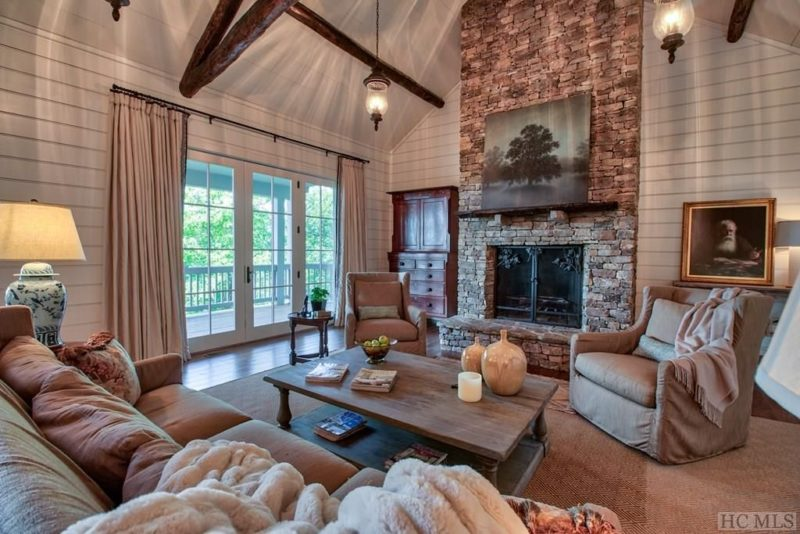 A view of a living room filled with furniture and a fireplace