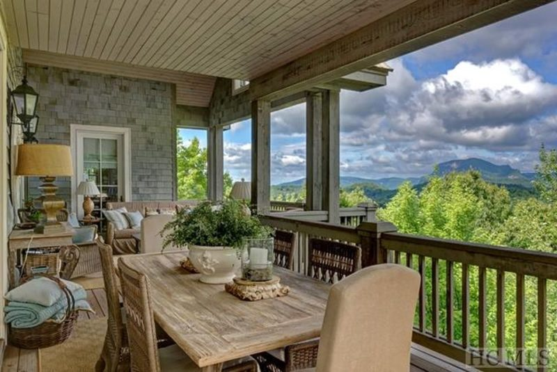 Dining table and chairs on back porch