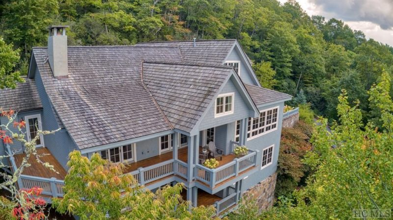 Aerial view of back exterior of house in mountains