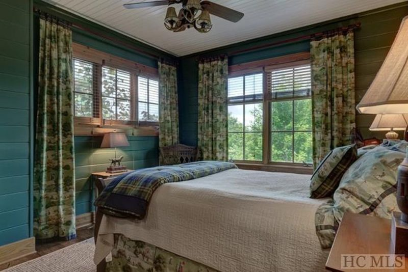 Bedroom with green walls and floral curtains
